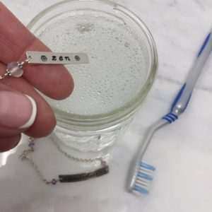 liquid soap and warm water for cleaning silver jewelry
