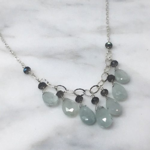 7 drops of aqua marine paired with labradorite on sterling silver chain.