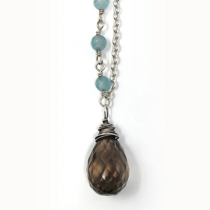 Smokey quartz wire wrapped with aqua marine detail on chain