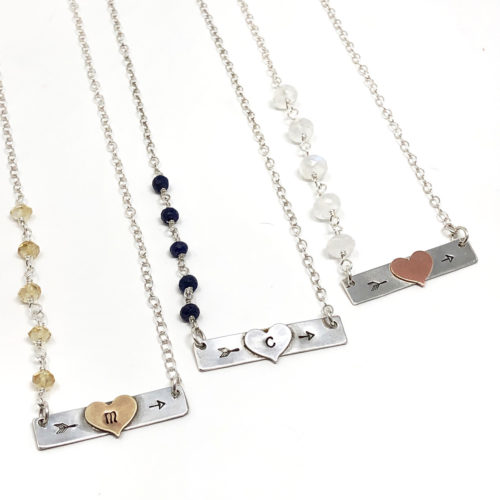 Bar necklaces with soldered heart with initial and gemstones.